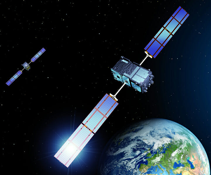 Two GPS Satellites Orbiting Earth